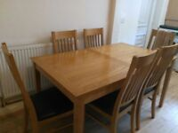 Extendable Wood Dinning Table and Six Chairs