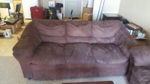 Two couches and arm chair