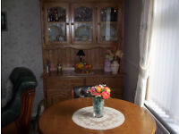 Real wood dining room table, chairs and sideboard.