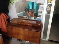It is a beautiful old wooden dressing table.