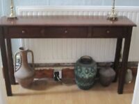 Dark wood hall console table with three drawers