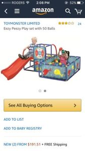 Used eezy peezy ball pit with over 100 balls
