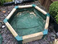 Large wooden hexagonal sandpit or planter