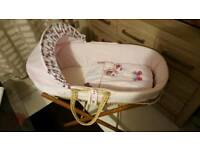 Pink moses basket with a stand and mattress