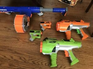 Lot of Nerf guns and 8 darts.