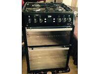 Beko black & silver double oven gas cooker 60 cm wide.