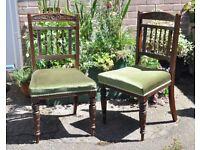 Pair of dark wood carved chairs