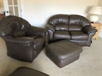 Two seater settee, large armchair and storage footrest.