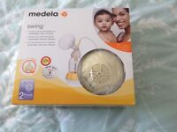 Medela swing electric breast pump with calma, £50