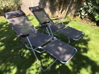 Two practically new reclining sun lounger chairs