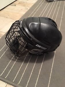 Men's or woman's hockey helmet with cage.