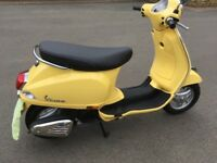 Eye catching custard yellow Piaggio Vespa 125cc scooter only 844 kilometres.