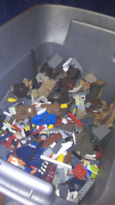 Bin filled with Lego and more