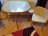 The table and leather chairs