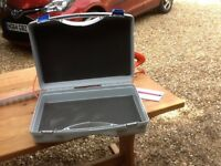 Small case, light grey in colour.