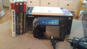 PSP console and 4 PSP games.120.00
