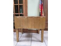 Wooden kitchen table with 2 fold out leaves. Good condition.Selling to make way for bigger family.