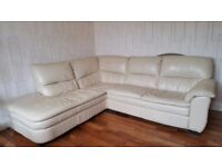 Large L Shaped Cream Leather Sofa.