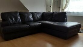 dark blue leather corner sofa and footstool