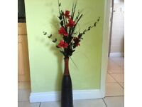 Pretty vase with red flowers