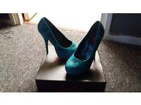 Iron fist teal heels size 7