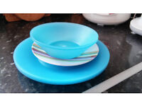 Plastic Plates and Bowls - Free to collect.