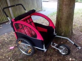 Double buggy bicycle trailer - jogger hardly used in classic red - black with mesh and raincover