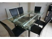 Glass extending dining table with 6 chairs