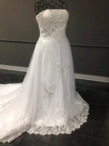 Brand new wedding dress. Lace and embellishments.