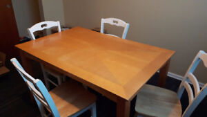 Wooden dining table with four matching chairs