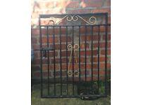 Black metal gate with gold motifs for garden