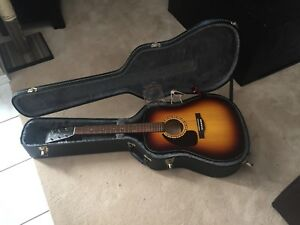 Left handed acoustic guitar with case