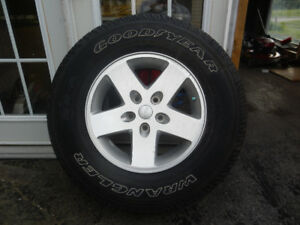 255 75R 17 ONE BRAND NEW TIRE ON OEM  17 in ALLOY RIM $95