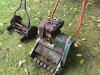 Two very old, very rusty, Lawnmowers