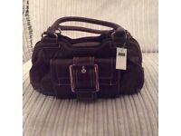 Small burgundy handbag
