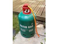 13kg Calor Propane canister with regulator, almost full