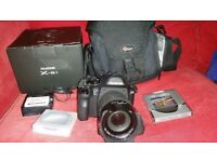 Fujifilm X-S1 with carry bag, spare battery, 33gig memory card and filters boxed