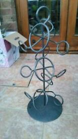 Funky wine bottle stand made of metal