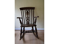Dark wood fiddle back rocking chair would need to be collected