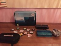 Aqua blue Nintendo 3DS including 11 games, case, stand and charger all in box has been used