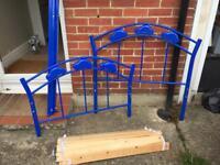 Child's car theme bed frame blue.