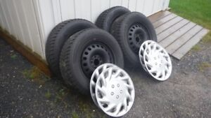 For Sale 4 Winter Tires Rims And Hub Caps