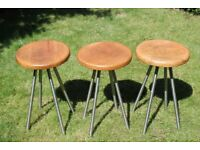 Three pine and stainless steel stools.