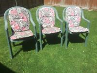 3 plastic garden chairs stackable with cushions. Can deliver.