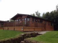 Fossil Lodge is a beautiful wooden lodge located on a private road at Haggerston Castle Holiday Park