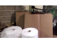 20 large packing boxes and 2 large rolls of bubble wrap £20