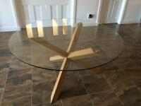 Glass dining table with solid oak legs