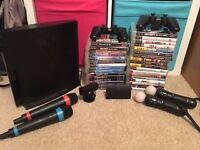 PS3 Bundle: 32 Games, 2x Remotes, 2x Wireless Singstar Mics, 2x Playstation Move Remotes