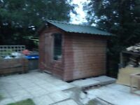 Timber shed, pitch roof, external dimensions 2460 x 2500mm.