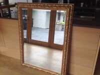 Gold leaf rectangular framed mirror. Bevelled glass, solid. Size : 46 by 36 inches